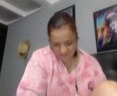 Webcam show  with latinaamorosa. Redhead with medium tits